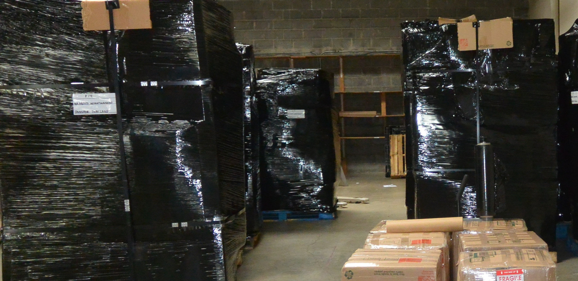 Black shrink wrap to ensure safety and so the pallets are tight and compressed.