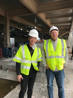 Phil Castellano and Scott Aker inspecting construction progress at a design-build site.