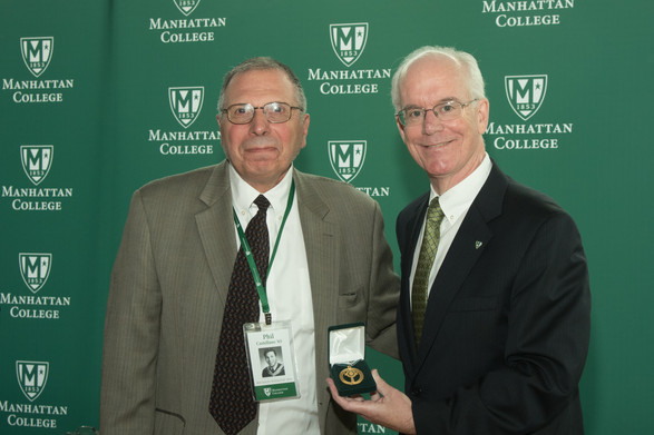 Phil Castellano presented with an achievement award during his reunion at Manhattan College.
