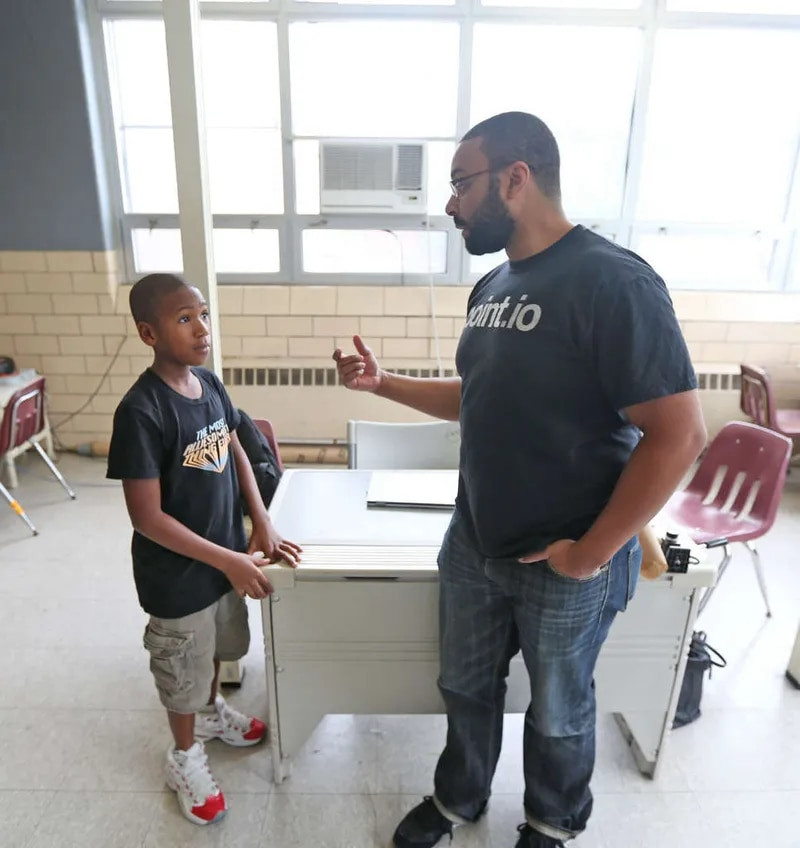 Sylvester Mobley helps students during a Coded by Kids class. Mobley founded Plain Sight Capital to invest in BIPOC entrepreneurs in the tech space.