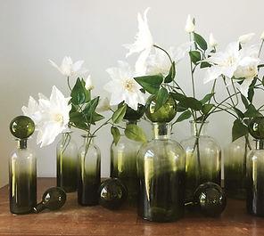 Faux flowers in modern bottle vases