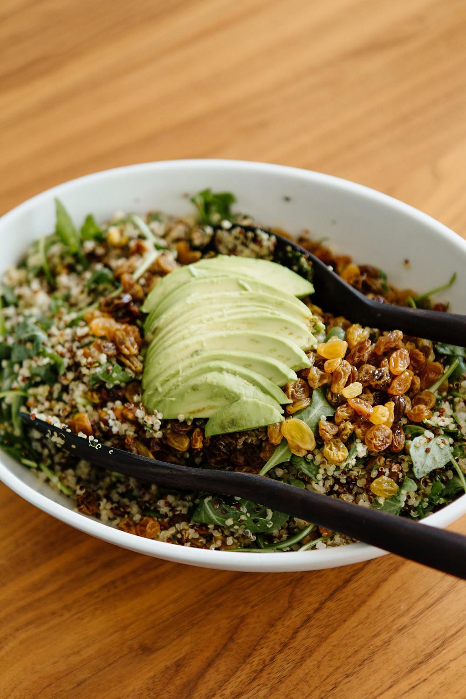 Quinoa salad with avocado, pistachios, and raisins