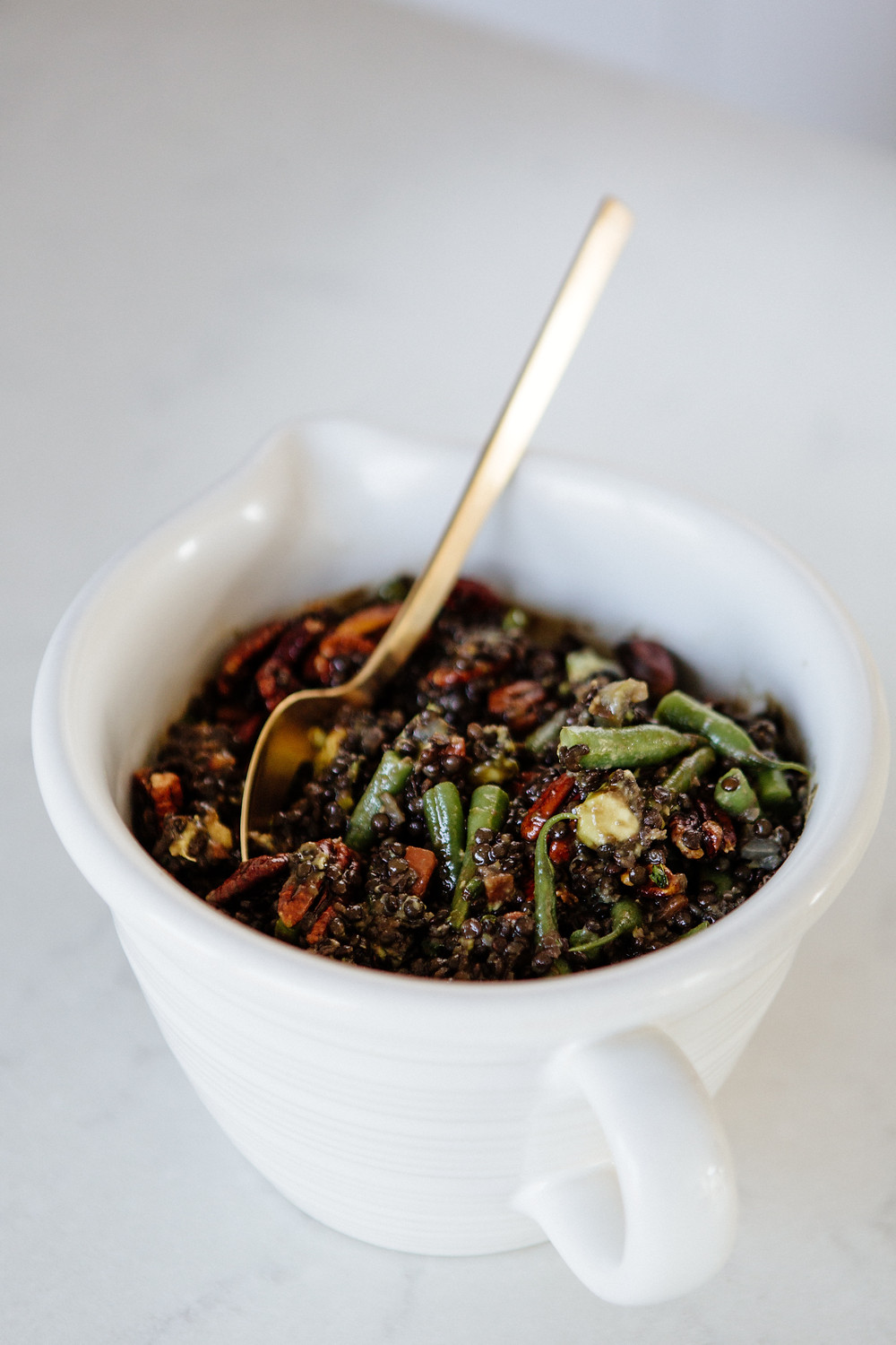 Lentil salad with avocado, green beans, and pomegranate molasses