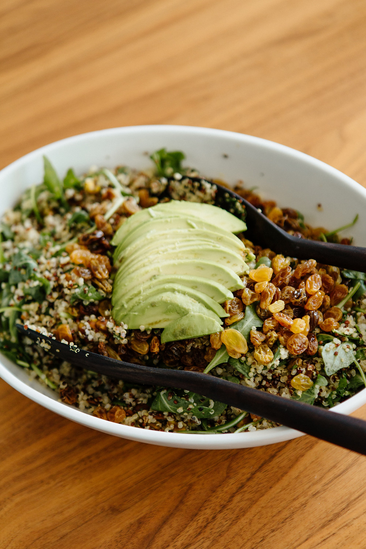 Quinoa salad with avocado, pistachios, and golden raisins