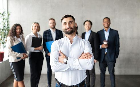 confident-arabic-businessman-standing-in-front-of--PEXQM2K.jpg