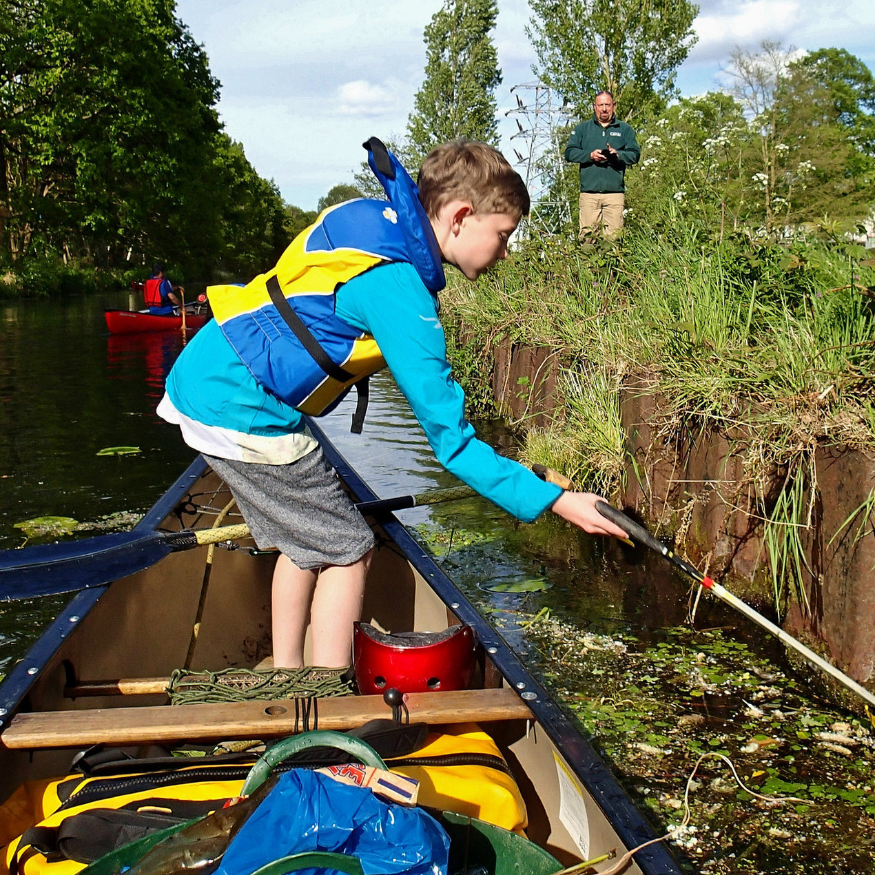 Young Shaun litter picking by canoe