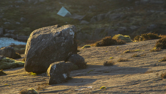 Rock slabs, distant camp, Rhinogs