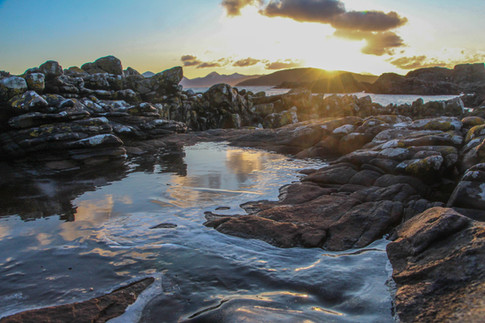 Frozen rock pool at sunset