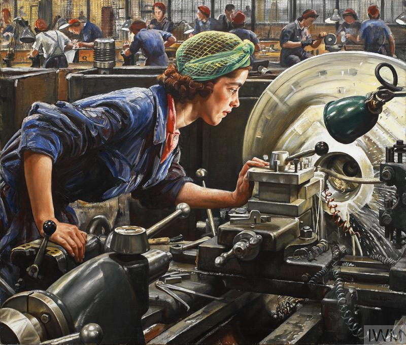 portrait of a female factory worker operating a lathe