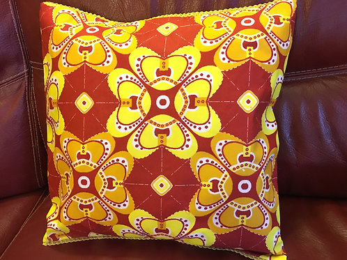 Housse de coussin Wax multicolore origami orange/jaune bord galon