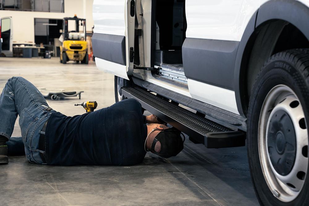 Technician Working On Sprinter Camper Van