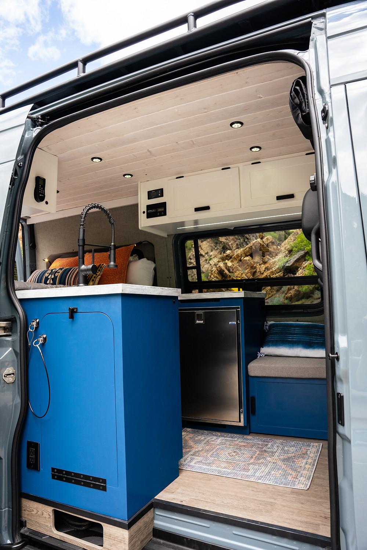 Custom Sprinter Camper Van in Mountains by VanBuilders