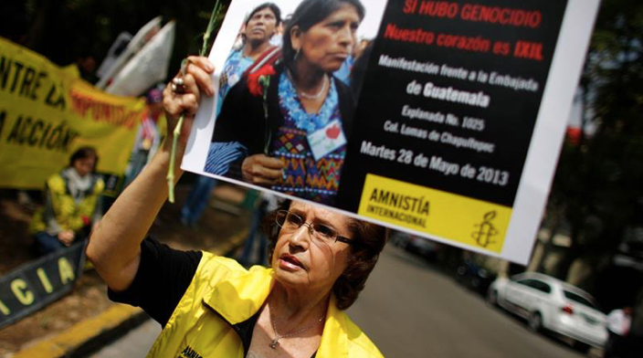 Relatives of genocide victims and survivors around the country celebrated the news of Mendoza's arrest [Tomas Bravo/Reuters]