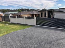 Slat sliding gate with modular wall