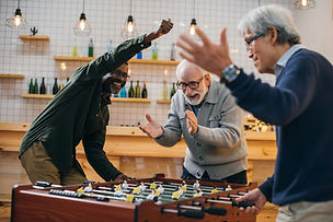 Old aged people playing foosball