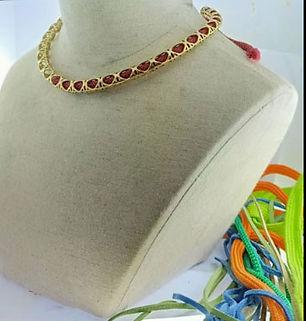 collier ajoure          cuir metal