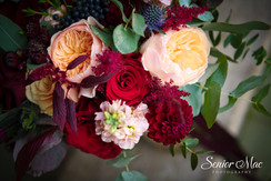 Peach and red berry bridal bouquet flowers