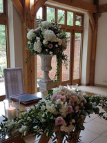 Ceremony flowers pedestal and long and matching long and low