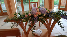 Pink & Blue Long & low registrars table flowers