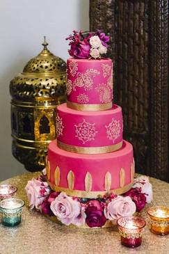 Shades of pink wedding cake flowers