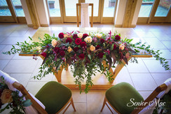 Garden style ceremony long and low flowers