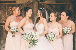 Peachy Pink Bridal party white flowers