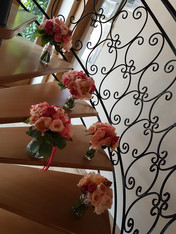 Vibrant coral sunset Bridal Bouquets on staircase