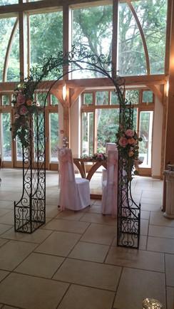 Wedding arch flowers ornate metal frame