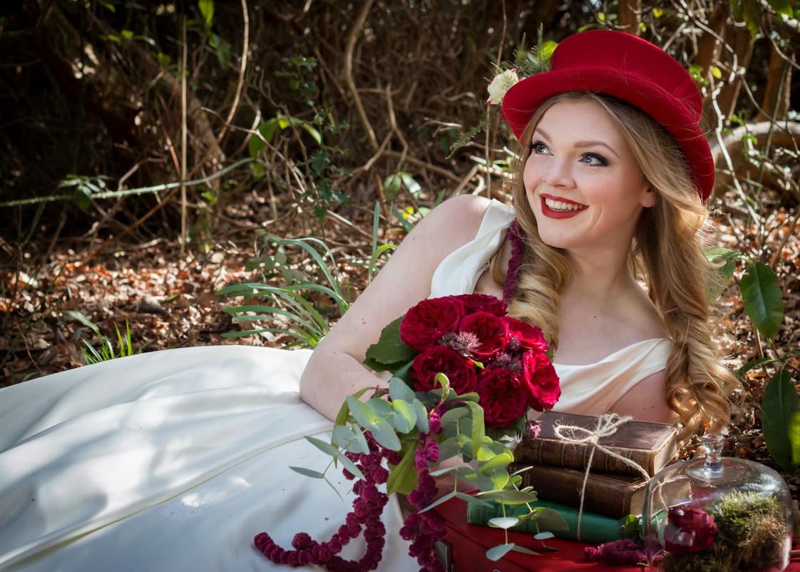 Alice in wonderland red rose wedding bouquet