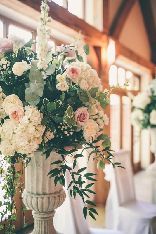 Romanticc wedding pedestal urn flowers
