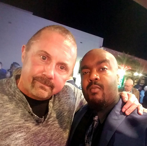 """Chad Eric Smith w/ actor Kane Hodder, best known for his portrayal of Jason Voorhees in four films from the Friday the 13th series, at the red carpet screening of """"An Accidental Zombie Named Ted"""". (November 30, 2017)"""