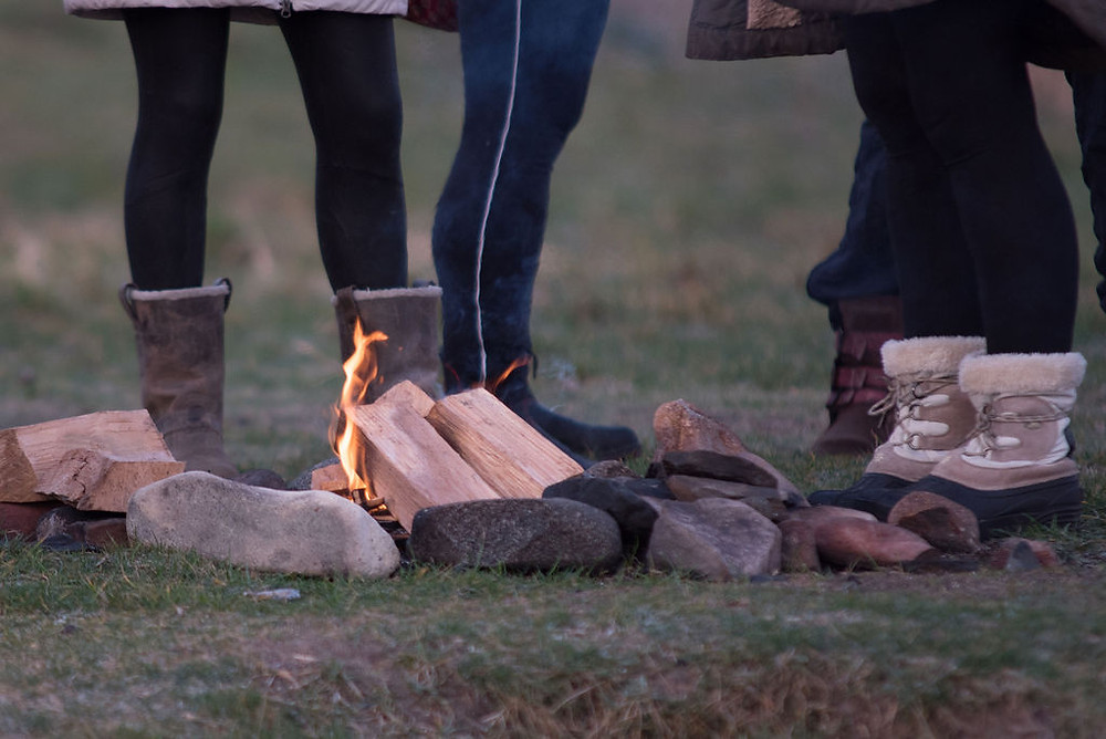 Bonfire time to warm up after their dip on International Women's Day 2019: Photo credit: Anna Deacon