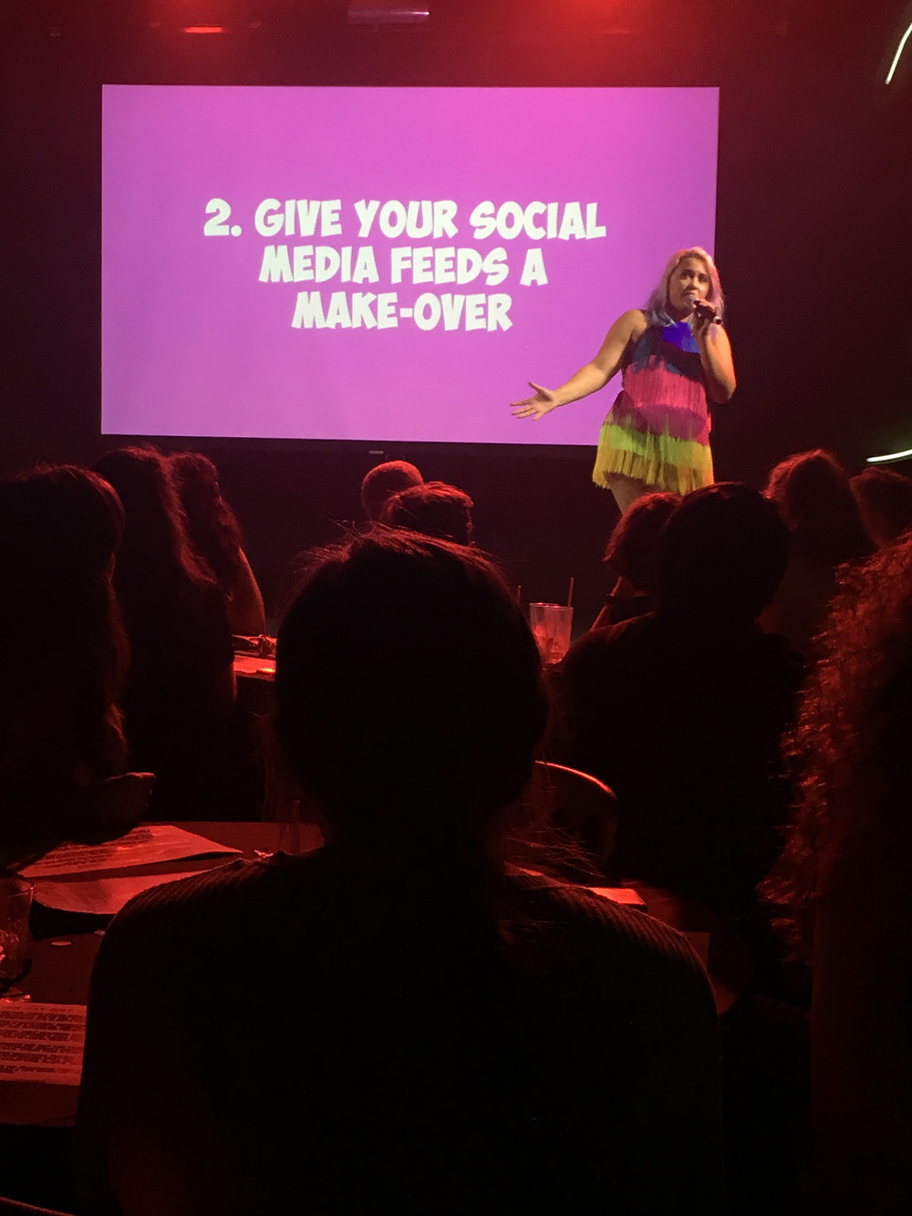 Megan Jayne Crabbe on stage at Never Say Diet Club, 2018