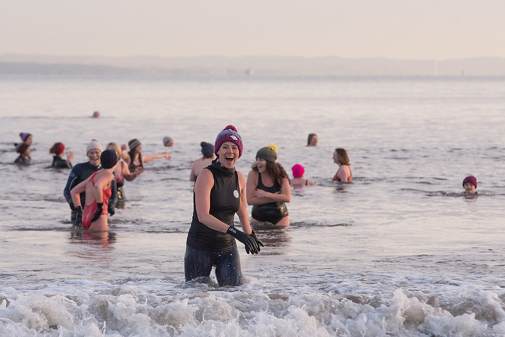 Evelyn Simpson loving her quick dip for International Women's Day 2019. Photo credit: Anna Deacon