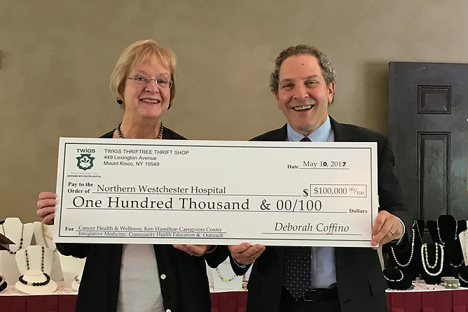 Twigs President, Maureen Kilfoyle, presents NWH President, Joel Seligman, with $100,000 check at Spring 2016 luncheon.
