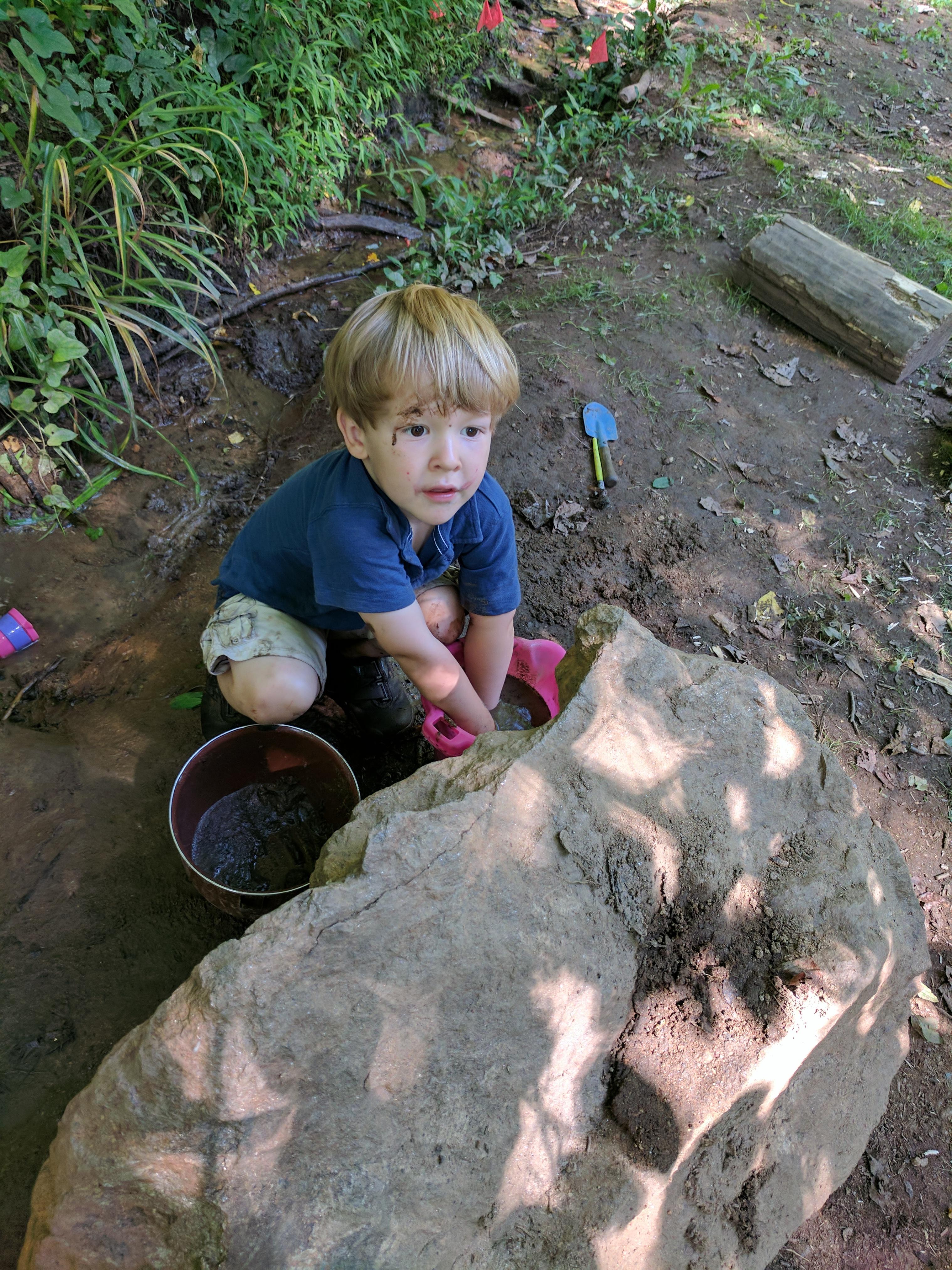 Asheville-farmstead-kids-creek-play-mud
