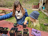 teacher_student_plants_potting_outdoors_