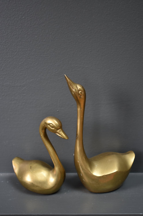 Two small brass swans