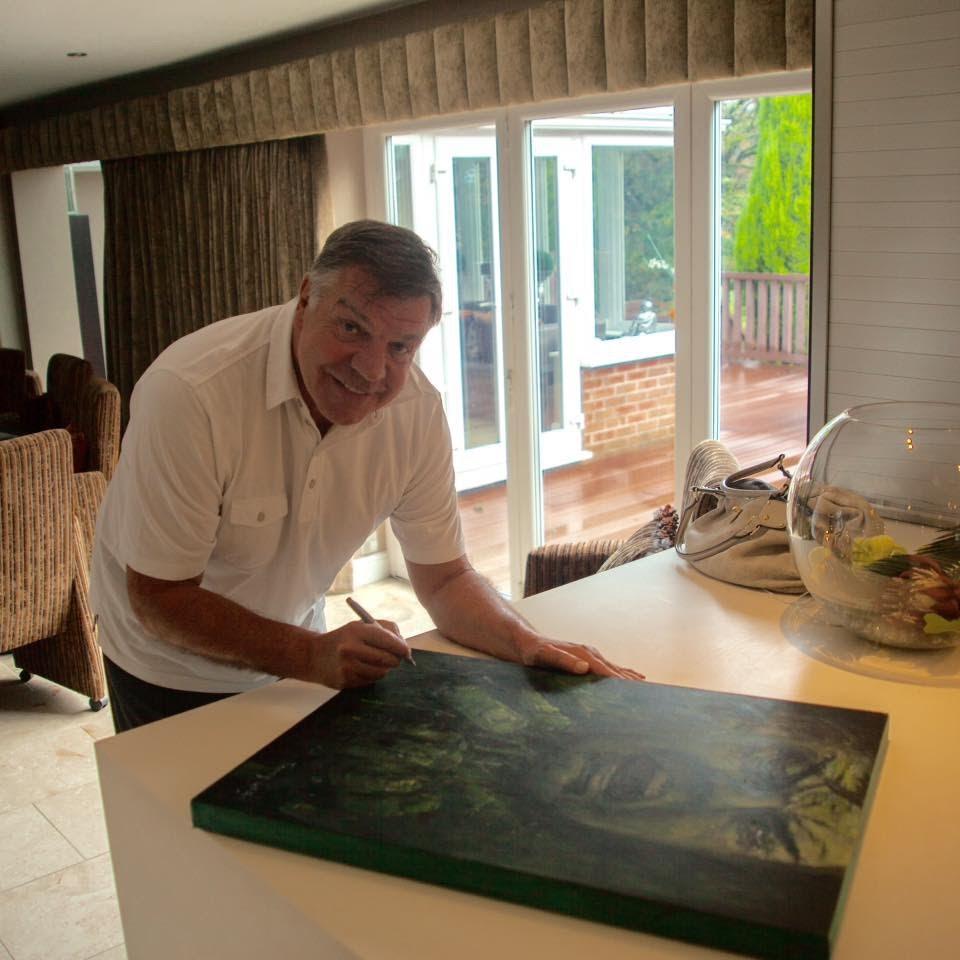 Big Sam signing his portrait