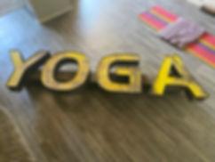yellow yoga sign.jpg