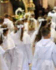 Los niños en la primera comunión