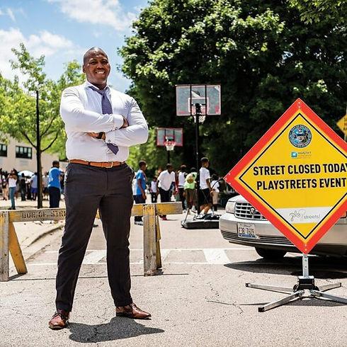 Kam Standing by Sign.jpg