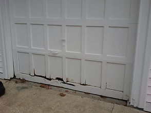 Old/damaged garage door replacement