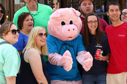 BBQ Mascot poses with smiling fans
