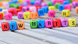 New Habits words on wooden table.jpg