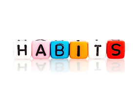 colorful word cube of habits on white ba