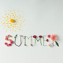 Word _SUMMER_ made of flowers on bright