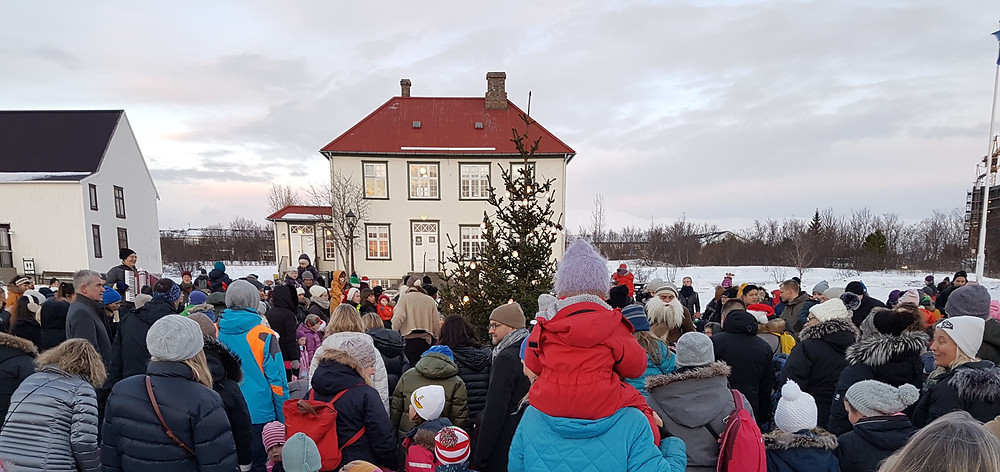 Singing and Dancing around the Christmas Tree at Árbær Open Air Museum, Reykjavík, Iceland