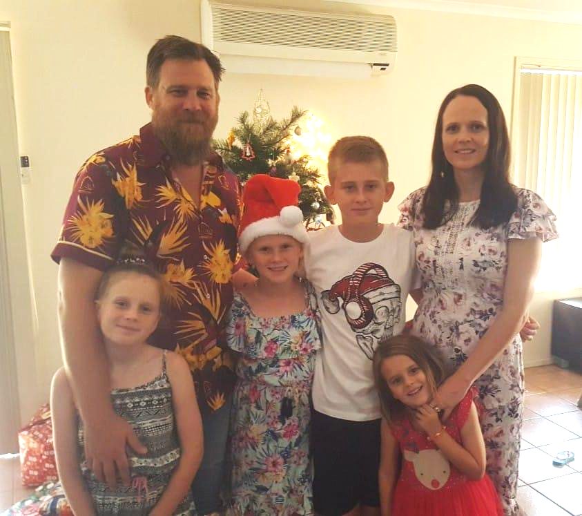 Elin with her husband, three daughters, and son in their home at Christmas time