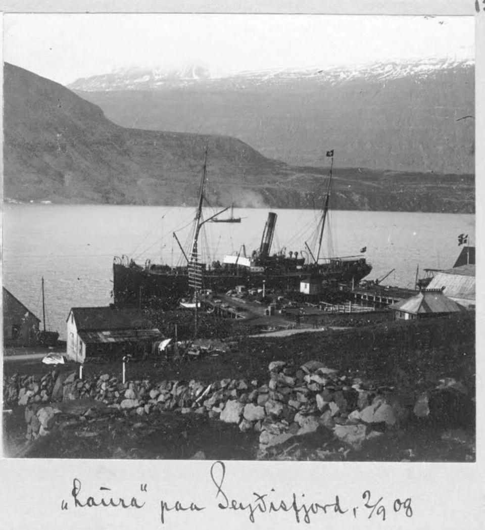 a black and white image of the ship Laura docked in Seyðisfjörður